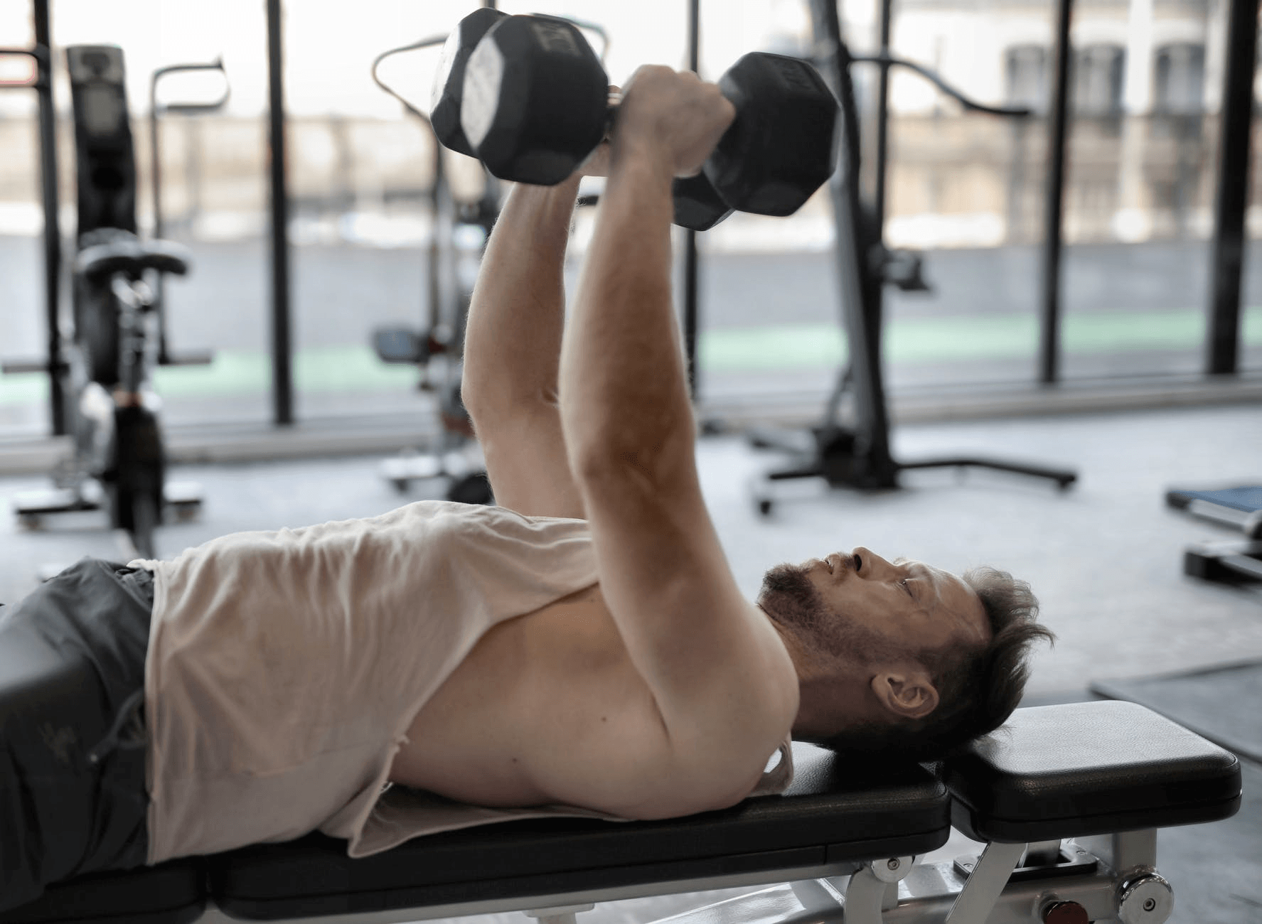 Man training with dumbbells